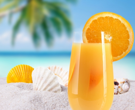 frozen fruit: Fruit cocktail on a beach Stock Photo