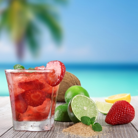 cocktail glasses: Fruit cocktail on a beach Stock Photo