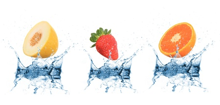 Fruit falling into water over white  Stock Photo - 14730645