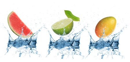 Fruit falling into water over white  photo