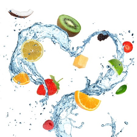 Fruit in water splash hart Stockfoto
