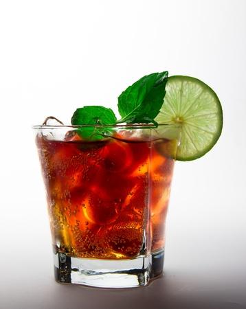 Cuba libre drink over white