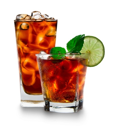 soft drink: Cola glasses with ice cubes over white Stock Photo