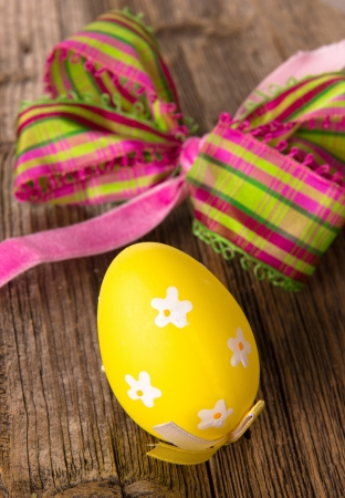 Painted Easter Eggs on wooden background  photo