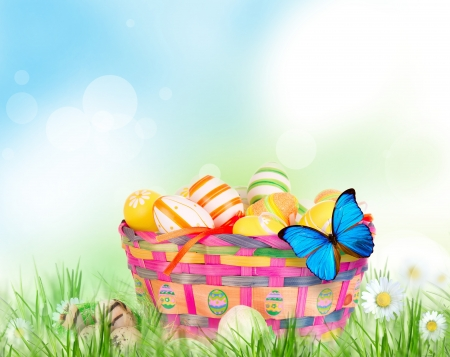Colorful painted easter eggs in basket photo