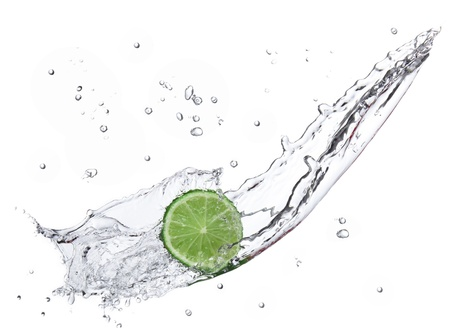 Fresh lime with water splash isolated on white  photo