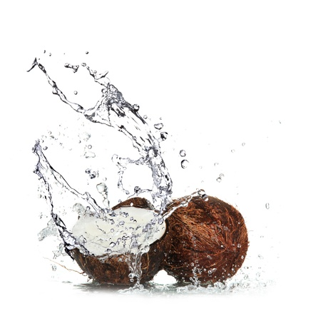 coco palm: Coconut with water splash over white  Stock Photo