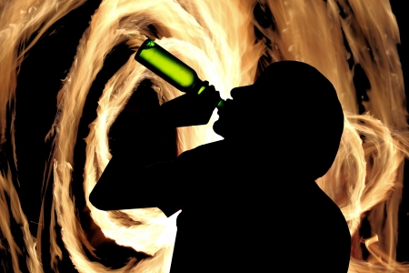 Silhouette of drinking man photo