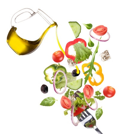 Fresh salad with poured olive oil  photo