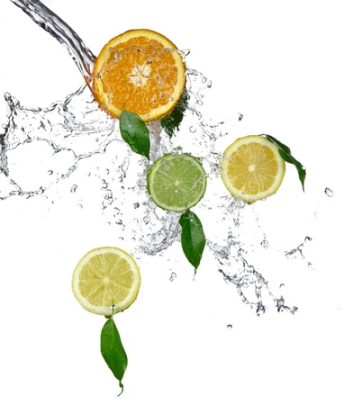 falling water: Fresh citrusses with water splash isolated on white