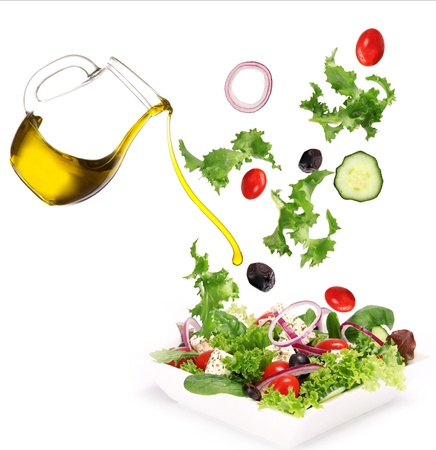 poured: Fresh salad with poured olive oil  Stock Photo