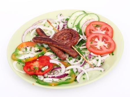 tzaziki: Sausages with fresh vegetable