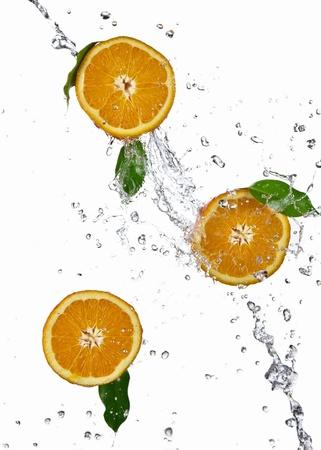 Orange splashing isolated on white  photo