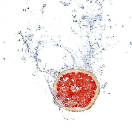 soda splash: Fresh grapefruit with water splash isolated on white Stock Photo