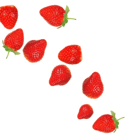 Strawberries in milk splash over white background  photo