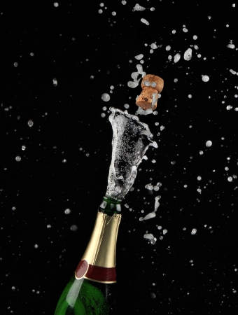 champagne pop: Close-up of explosion of champagne bottle cork  Stock Photo