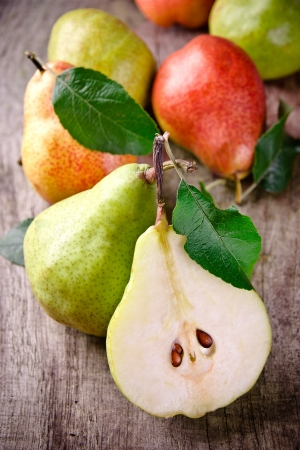 Freshly harvested pears on wooden background
