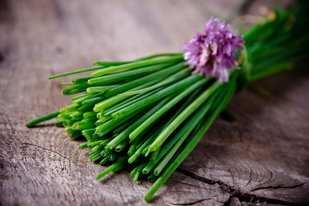 chive: Fresh  chive on wooden background Stock Photo