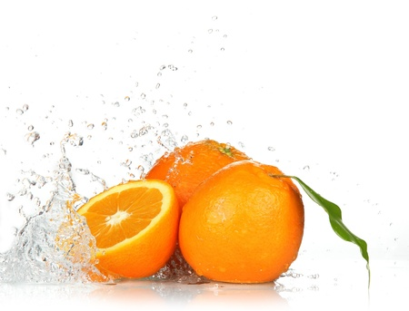 fruit drop: Orange fruits and Splashing water  Stock Photo