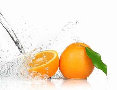 Orange fruits and Splashing water  photo