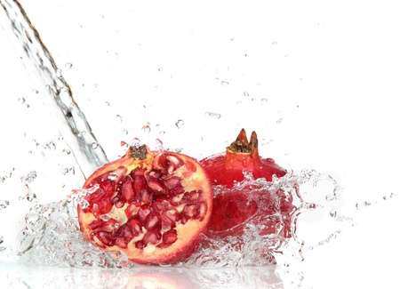 red water: Juicy pomegranate with splashing water  Stock Photo