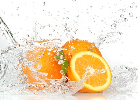 soda splash: Orange fruits and Splashing water  Stock Photo