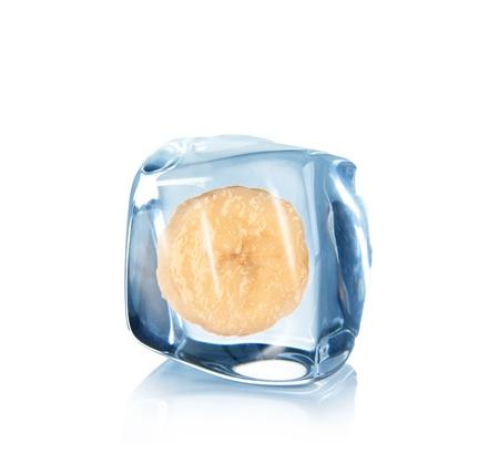 Slice os banana in Ice cube over white  photo