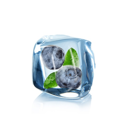 Blueberries in Ice cube over white