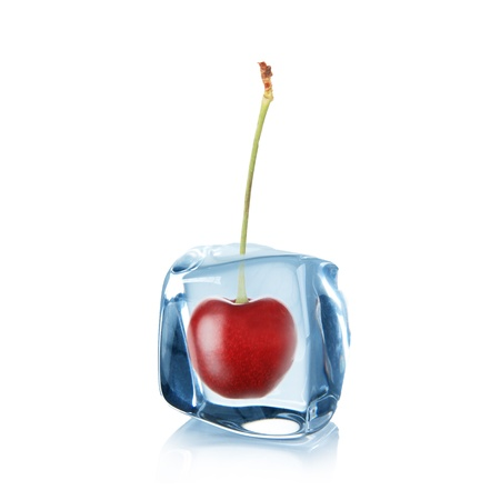 Cherry in Ice cube over white  photo