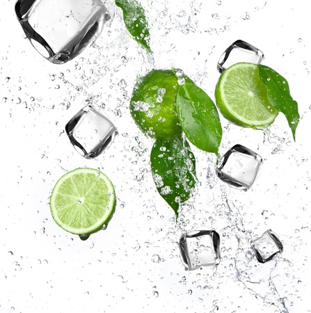 Limes with water splash and ice cubes