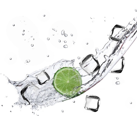 Limes with Ice cubes and water splashing  photo
