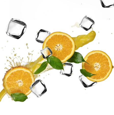 Oranges with splashing juice and ice cubes  photo