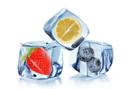 Fruits in Ice cubes over white photo