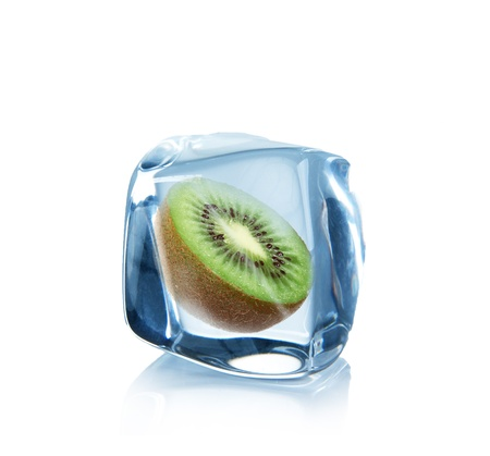 Kiwi in Ice cubes over white photo