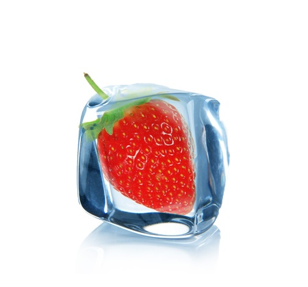 Strawberry in Ice cube over white