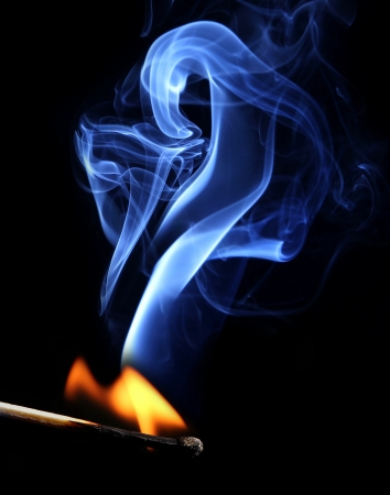 lit candle: Ignition of match with smoke  Stock Photo