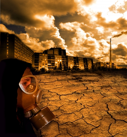 Cracked ground with woman in gas mask photo