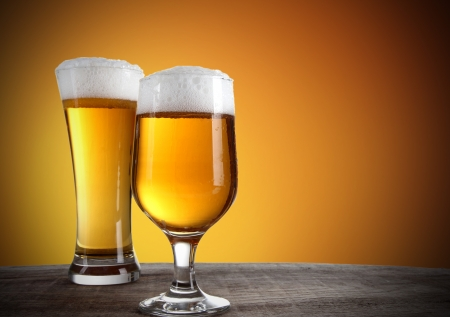 Beer glasses with gold background Stock Photo - 15146605