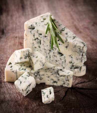 different types of cheese: Blue cheese on wooden background