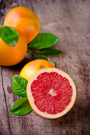 Freshly harvested grapefruit on wooden background  photo