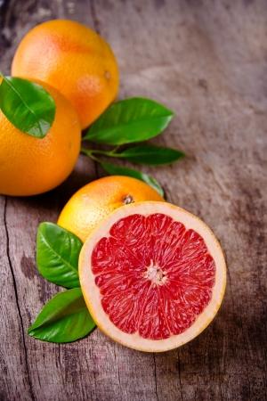 grapefruit: Freshly harvested grapefruit on wooden background