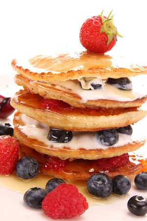 Small pancakes topped with honey photo
