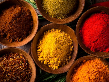 Assorted spices with fresh herbs photo