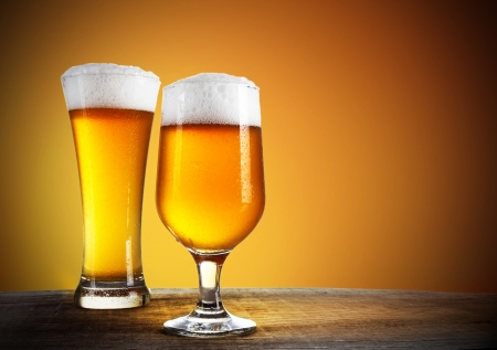 Beer glasses with gold background  Stock Photo - 15365452