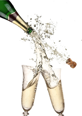 Pair of champagne flutes making a Champagne splash  Stock Photo