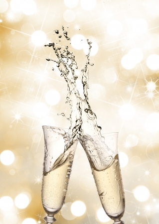 champagne flutes: Pair of champagne flutes making a Champagne splash  Stock Photo
