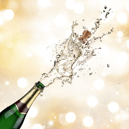 Close-up of champagne explosion photo