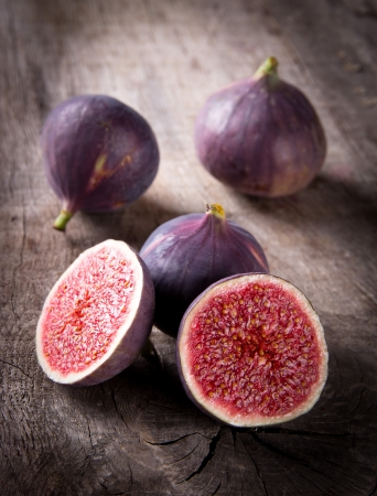 halved  half: Fresh figs on the wooden table