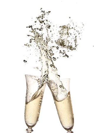 Pair of champagne flutes making a Champagne splash  photo