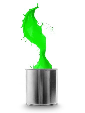 Green paint splashing out of can, isolated on white background photo